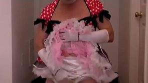 Diapered sissy in pretty red dress triple diapered to insure no leaks