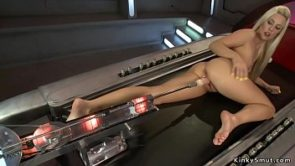 Slim blonde fucks anal machine