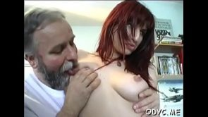 Skilled redhead Jessica with massive natural tits gets crotch licked