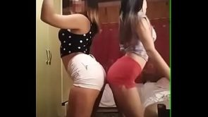 Two friends dancing reggaeton